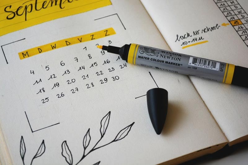 paper calendar with highlight reminders