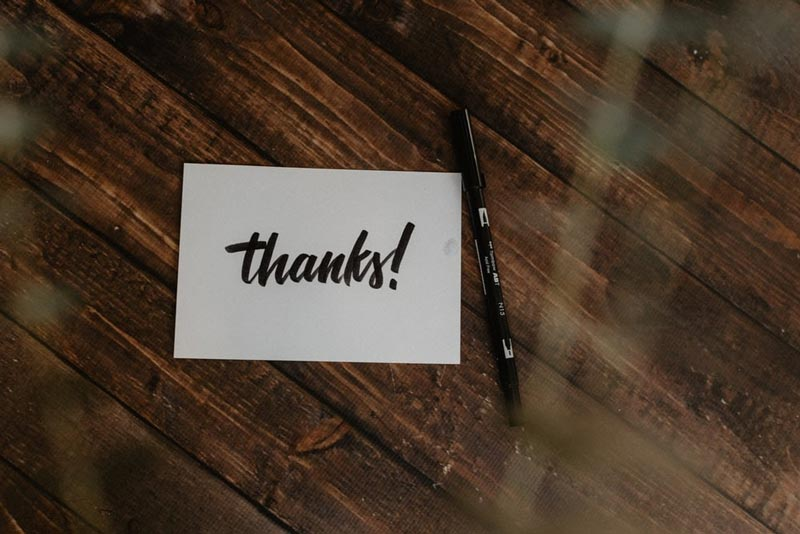 thank you card on a wooden table