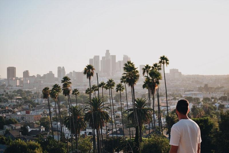 man looking at los angeles skyline